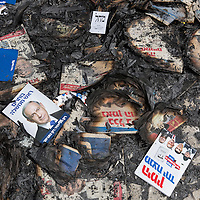 "Israel, Jerusalem, Charred remains of election posters for Benjamin (Binyamin) ""Bibi"" Netanyahu in city sidewalks during March, 2015 elections"