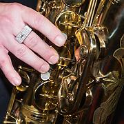 NLD/Amsterdam/201400413 - Aankondiging Jazzfestival Amsterdam Arena met optreden Jules Deelder, Saxofoon