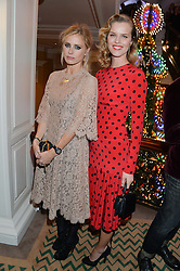 Left to right, LAURA BAILEY and EVA HERZIGOVA at the Claridge's Christmas Tree By Dolce & Gabbana Launch Party held at Claridge's, Brook Street, London on 26th November 2013.