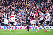 Aston Villa striker Jonathan Kodjia (26) is shown the red card by referee Mr Coote during the EFL Sky Bet Championship match between Fulham and Aston Villa at Craven Cottage, London, England on 17 April 2017. Photo by Jon Bromley.