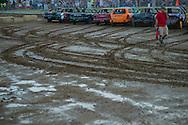 Competitor in the first heat of demolition derbys take their starting position at the Summitt County Fairgrounds, Thursday, July 26, 2016 in Tallmadge, Ohio. All cars participating had previously been used in at least one demoltion derby.
