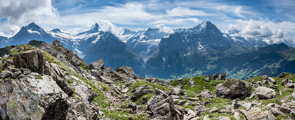Bernese Alps. Hike a very spectacular trail from Eigeralp farm at upper Bussalp, around Faulhorn to Bachalpsee, finishing at the gondola lift station at First, which descends to Grindelwald BGF. Grindelwald is in the canton of Bern, Switzerland, the Alps, Europe. Along this hike on a clear day, admire breathtaking array of peaks: Wetterhorn, Schreckhorn, Finsteraarhorn (highest mountain in the Bernese Alps, at 4274 m or 14,022 ft), Eiger, Mönch, and Jungfrau. Eigeralp.ch offers a wonderful traditional breakfast and farm stays, and can be reached as follows: ride the private GrindelwaldBus.ch to the last stop in Bussalp, then ascend 40 minutes on foot. The Swiss Alps Jungfrau-Aletsch region is honored as a UNESCO World Heritage Site. This image was stitched from multiple overlapping photos.