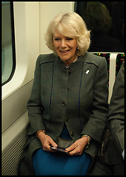 The Duchess of Cornwall holds her oyster card as her and Prince Charles  ride on a Tube Train on London's Underground from Farringdon to Kings Cross. To celebrate 150 years of the London underground, Wednesday January 30, 2013. Photo By Andrew Parsons / i-Images