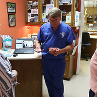Veterinarian Stephen King educates attendees of Saturday's Tupelo Small Animal Hospital's open house on dental health care for animals