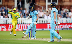 England's Ben Stokes reacts after being bowled out by Australia's Mitchell Starc during the ICC Cricket World Cup group stage match at Lord's, London.