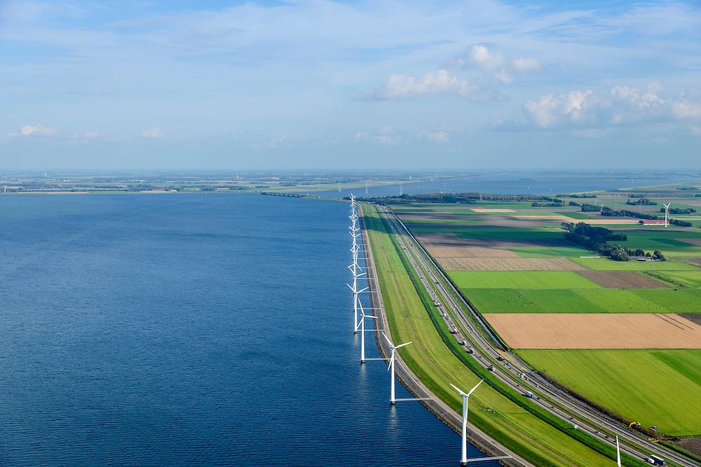 Nederland, Flevoland, Gemeente Lelystad, 10-10-2014. IJsselmeerdijk met windmolens, onderdeel van het windmolenpark (of windpark) van NUON in het water van het IJsselmeer. Omgeving van de Maximacentrale gezien naar de Noordoostpolder. Rechts autosnelweg de A6, links het water van het IJsselmeer.<br /> Windmills, part of the wind farm (or wind park) of NUON in the water of the IJsselmeer. Right the A6 motorway, left the water of the IJsselmeer.<br /> luchtfoto (toeslag op standard tarieven);<br /> aerial photo (additional fee required);<br /> copyright foto/photo Siebe Swart