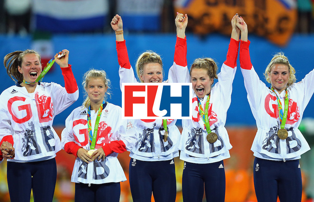 RIO DE JANEIRO, BRAZIL - AUGUST 19:  Great Britain players react with their gold medals after defeating Netherlands in the Women's Gold Medal Match on Day 14 of the Rio 2016 Olympic Games at the Olympic Hockey Centre on August 19, 2016 in Rio de Janeiro, Brazil.  (Photo by Tom Pennington/Getty Images)