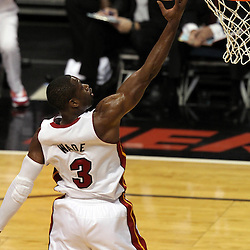 Jun 21, 2012; Miami, FL, USA; Miami Heat shooting guard Dwyane Wade (3) lays the ball up against the Oklahoma City Thunder during the first quarter in game five in the 2012 NBA Finals at the American Airlines Arena. Mandatory Credit: Derick E. Hingle-US PRESSWIRE