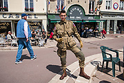 May 30, 2019, Sainte-Mère-Église, Normandy, France. A tourist dressed in military fatigues participates at  reenactments of military deeds from 1944. The 75th anniversary of D-Day and Battle of Normandy commemoration is a tourist attraction.   <br /> 30 Mai 2019, Sainte-Mère-Église, Normandie, France.  Un touriste habillé en treillis militaire participe à la reconstitution d'actes militaires de 1944. Le 75e anniversaire du débarquement  et la bataille de Normandie est une attraction touristique.