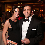 Monica Bennett, left, and Matt Bennett pose for a picture Saturday December 6, 2014 during the 9th Annual Wilmington Fur Ball at the Country Club of Landfall in Wilmington, N.C. (Jason A. Frizzelle)