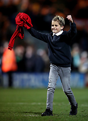A young fan receives a shirt from Marcos Rojo after the final whistle in the Emirates FA Cup, fourth round match at Huish Park, Yeovil.