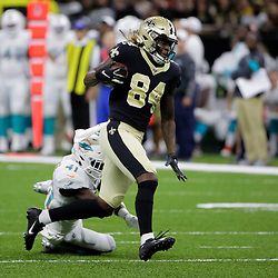 Aug 29, 2019; New Orleans, LA, USA; New Orleans Saints wide receiver Lil'Jordan Humphrey (84) catches a pass past Miami Dolphins defensive back Montre Hartage (41) during a preseason game at the Mercedes-Benz Superdome. Mandatory Credit: Derick E. Hingle-USA TODAY Sports