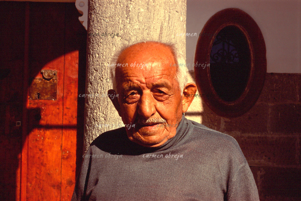old man in front of the old byzantine church of Kayseri, Cappadocia