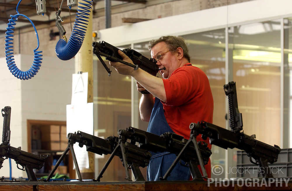 HERSTAL, BELGIUM - APRIL-15-2003 - Machine guns are assembled and inspected by hand at the FN Herstal weapons fabrication plant near Liege, Belgium. .(Photo © Jock Fistick)