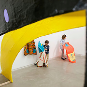 "March 10, 2012 - New York, NY : Six-year-old Alexandra Kucharz, right, and three-year-old Zach Kucharz play with hand-sewn costumes created by Japanese artist Misaki Kawai -- part of Kawai's installation ""Love from Mt. Pom Pom"" -- at the Children's Museum of the Arts in the south village on March 10. CREDIT: Karsten Moran for The New York Times"