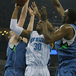 08 February 2009:  New Orleans Hornets forward David West (30) shoots between Minnesota Timberwolves defenders Kevin Love (42) and Al Jefferson (25) during a NBA game between the Minnesota Timberwolves and the New Orleans Hornets at the New Orleans Arena in New Orleans, LA.