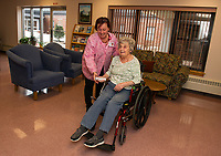 Recreation Director Brenda Twardosky sets up a game of Wii bowling with Anita Landry at the Belknap County Nursing Home Tuesday afternoon.  (Karen Bobotas/for the Laconia Daily Sun)