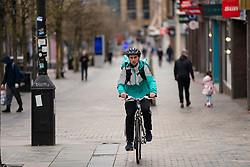 Glasgow, Scotland, UK. 26 March, 2020. Views from city centre in Glasgow on Thursday during the third day of the Government sanctioned Covid-19 lockdown. The city is largely deserted. Only food and convenience stores open. Pictured; Deliveroo cyclist on Sauchiehall Street. Iain Masterton/Alamy Live News