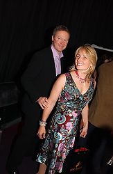 RORY BREMNER and his wife TESSA CAMPBELL-FRASER at a party hosted by jeweller Theo Fennell and Dominique Heriard Dubreuil of Remy Martin fine Champagne Cognac entitles 'Hot Ice' held at 35 Belgrave Square, London, W1 on 26th October 2004.<br />
