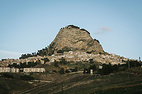 "SUTERA, ITALY - 8 JANUARY 2018: A view of the town of Sutera, in Sutera, Italy, on January 8th 2018.<br /> <br /> Sutera is an ancient town plastered onto the side of an enormous monolithic rock, topped with a convent, in the middle of the western half of Sicily, about 90 minutes by car south of the Sicilian capital Palermo<br /> Its population fell from 5,000 in 1970 to 1,500 today. In the past 3 years its population has surged  after the local mayor agreed to take in some of the thousands of migrants that have made the dangerous journey from Africa to the Sicily.<br /> <br /> ""Sutera was disappearing,"" says mayor Giuseppe Grizzanti. ""Italians, bound for Germany or England, packed up and left their homes empty. The deaths of inhabitants greatly outnumbered births. Now, thanks to the refugees, we have a chance to revive the city.""<br />  Through an Italian state-funded project called SPRAR (Protection System for Refugees and Asylum Seekers), which in turn is co-funded by the European Union's Fund for the Integration of non-EU Immigrants, Sutera was given financial and resettlement assistance that was co-ordinated by a local non-profit organization called Girasoli (Sunflowers). Girasoli organizes everything from housing and medical care to Italian lessons and psychological counselling for the new settlers.<br /> The school appears to have been the biggest beneficiary of the refugees' arrival, which was kept open thanks to the migrants.<br /> Nunzio Vittarello, the coordinator of the E.U. project working for the NGO ""I Girasoli"" says that there are 50 families in Sutera at the moment."