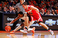 CHAMPAIGN, IL - JANUARY 05: Tracy Abrams #13 of the Illinois Fighting Illini and Aaron Craft #4 of the Ohio State Buckeyes scramble for a loose ball at Assembly Hall on January 5, 2013 in Champaign, Illinois. (Photo by Michael Hickey/Getty Images) *** Local Caption *** Tracy Abrams; Aaron Craft
