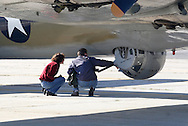 Montgomery, N.Y. - A  couple looks at the ball turret on a B-17 Flying Fortress at Orange County Airport in Montgomery on Sept. 29, 2006. The World War II bomber was at the airport as part of the Wings of Freedom Tour.