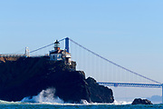 The Point Bonita Lighthouse in the Golden Gate national Recreation Area in San Francisco, CA, USA, as seen from a boat on the ocean,