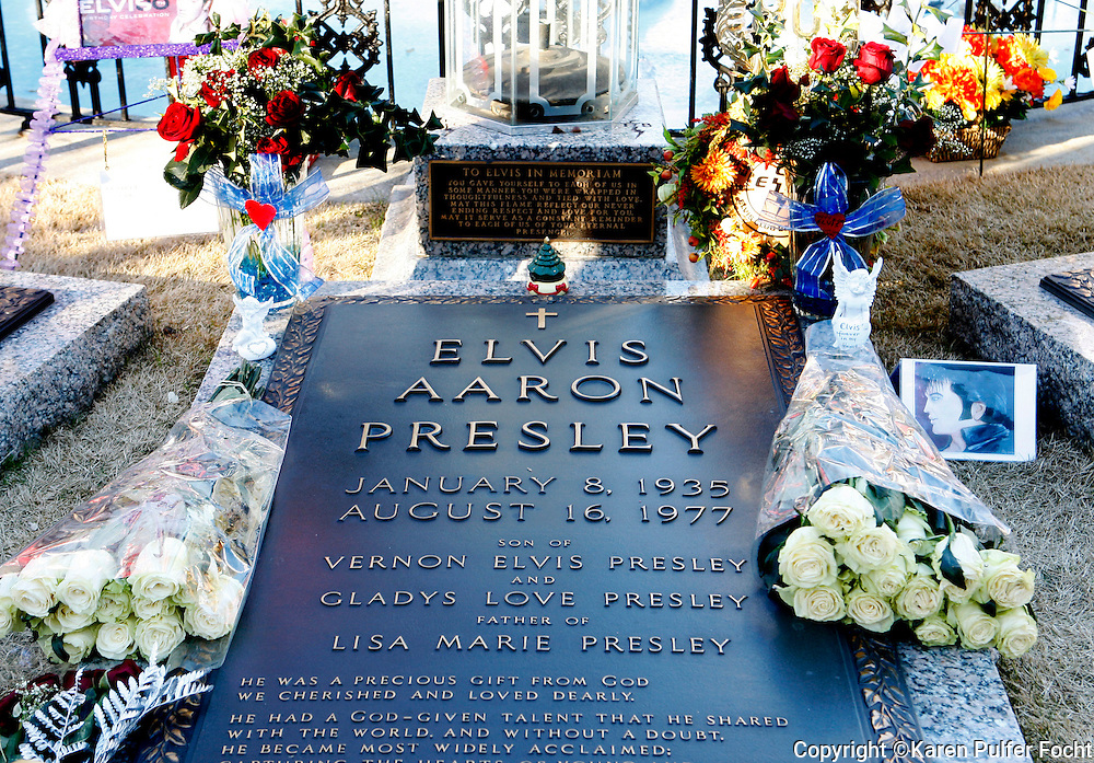The grave of Elvis Presley at Graceland in Memphis, Tennessee. Elvis Pilgrims converge on Graceland in Memphis, Tennessee each August and take part in a candlelight vigil in honor of the King of Rock and Roll. Graceland is planning huge expansions in 2016-2017.