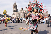 Mexico City-Jan 13: Indigenous Aztec tribal dancers performing in traditional dress on 13 Jan in Zocalo, Mexico City Distrito Federal