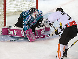 01.12.2016, Keine Sorgen Eisarena, Linz, AUT, EBEL, EHC Liwest Black Wings Linz vs Dornbirner Eishockey Club, 25. Runde, im Bild Tormann Michael Ouzas (EHC Liwest Black Wings Linz) und James Livingston (Dornbirner Eishockey Club) // during the Erste Bank Icehockey League 25th round match between EHC Liwest Black Wings Linz and Dornbirner Eishockey Club at the Keine Sorgen Icearena, Linz, Austria on 2016/12/01. EXPA Pictures © 2016, PhotoCredit: EXPA/ Reinhard Eisenbauer