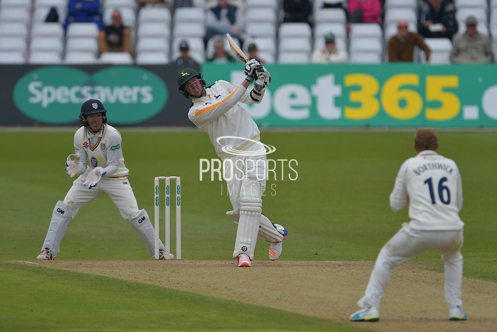Jake Ball launches Scott Borthwick for six during the Specsavers County Champ Div 1 match between Nottinghamshire County Cricket Club and Durham County Cricket Club at Trent Bridge, West Bridgford, United Kingdom on 29 May 2016. Photo by Simon Trafford.