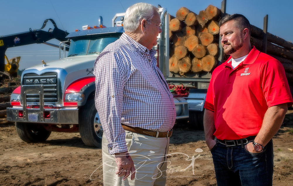 Tracy Gunter Jr. and his son, Tracy Gunter III, discuss a project in front of one of the Mack Granites they use in their logging business, Nov. 16, 2016, in Steadham, S.C. The men own and operate Tracy's Logging and T3 Chipping, where they oversee four logging crews and two chipping crews, averaging 300 loads per week. (Photo by Carmen K. Sisson)