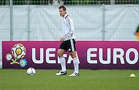 FUSSBALL INTERNATIONAL  EURO 2012   07.06.2012  Training der Deutschen Nationalmannschaft in Danzig Miroslav Klose (Deutschland) vor einer Werbebande UEFA EURO 2012