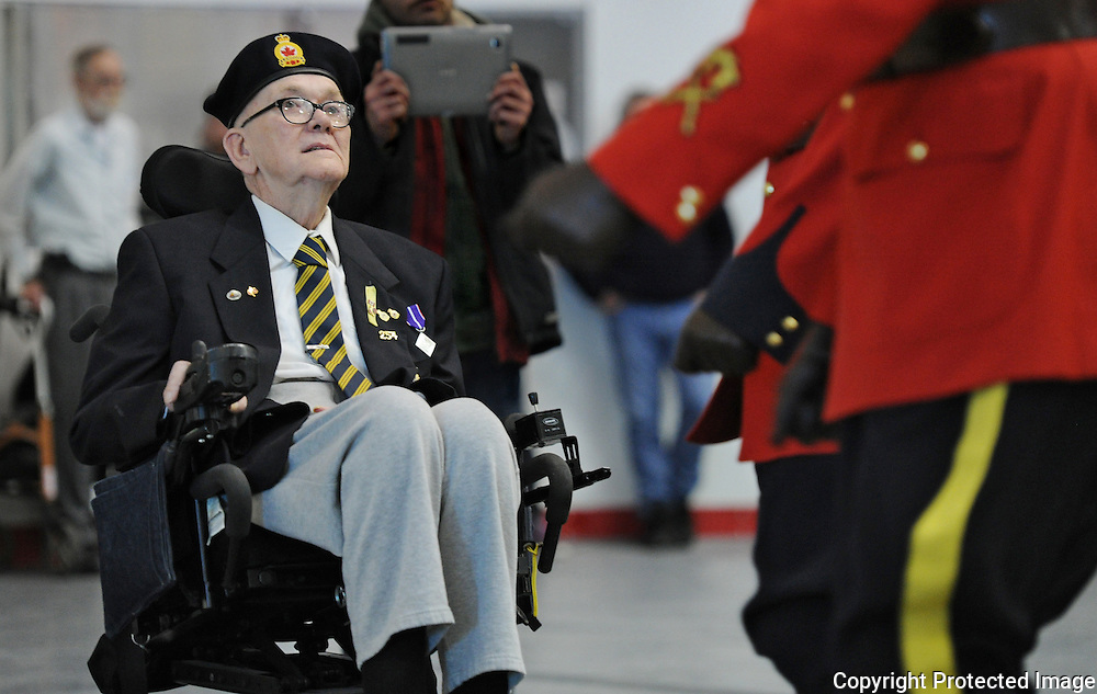 Ian Stewart/Yukon News<br /> Len Heibert, a veteran of the Korean War, watches as the RCMP march out after the Remembrance Day ceremony at the Canada Games Centre on Monday. See more from the ceremony on page 24.