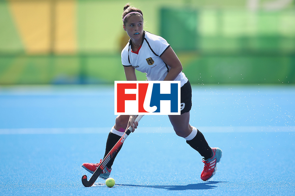 RIO DE JANEIRO, BRAZIL - AUGUST 17:  Pia-Sophie Oldhafer of Germany runs the ball forward during the womens semifinal match between the Netherlands and Germany on Day 12 of the Rio 2016 Olympic Games at the Olympic Hockey Centre on August 17, 2016 in Rio de Janeiro, Brazil.  (Photo by Mark Kolbe/Getty Images)