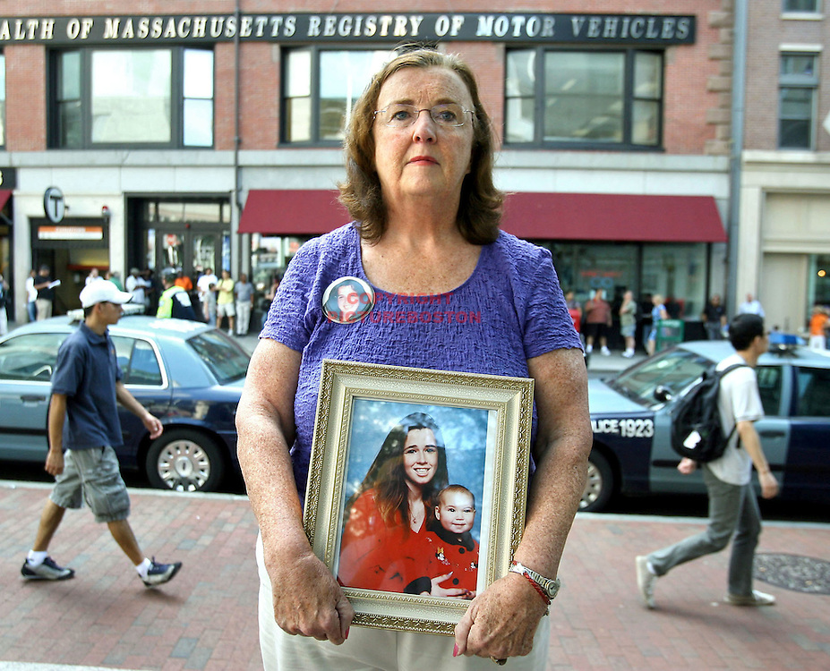 (08/06/09-Boston,MA) Barabara Roche, age 60, is seen this morning in front of the Registry of Motor Vehicles. She holds a photo of her daughter Christine Griffiths who was killed by drunken-driver William Foley Jr. in 2001. This morning she attended a hearing where Mr. Foley tried to have his licence reinstated. Staff photo by Mark Garfinkel
