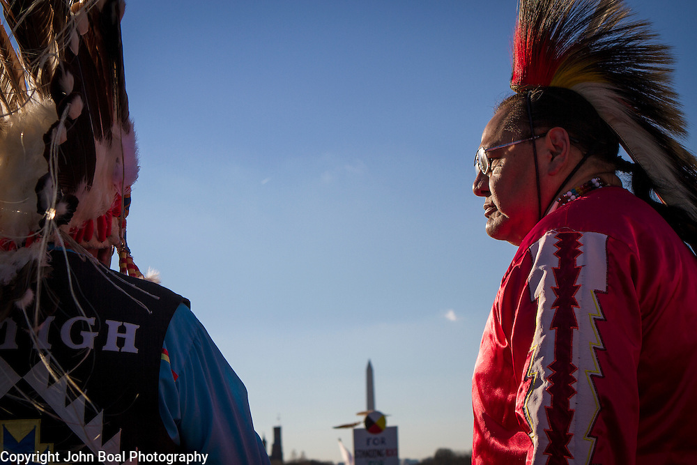 Dennis Zotigh, Kiowa, right, and his father, Ralph, speak during a protest and march from in front of the U.S. Capitol to the EPA, about the North Dakota Access Pipeline, as well as the effort to free Leonard Peltier.  Saturday, December 10, 2016. John Boal Photography
