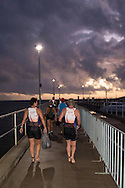 Competitors make their way out to the swiom start. Ironman Cairns and Ironman Cairns 70.3 Race. 2013 Ironman Cairns Triathlon Festival. Cairns, Queensland, Australia. 09/06/2013. Photo By Lucas Wroe