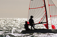 Miami, FL, USA, January 4, 2014 - The team of Sam Thompson and William Fuse of Kingston Yacht Clut caputred in silhouette sailing at ease between races at the 29er Nationals hosted by Coconut Grove Sailling Club on January 1-4, 2014.