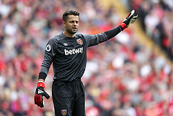 """West Ham United goalkeeper Lukasz Fabianski during the Premier League match at Anfield, Liverpool. PRESS ASSOCIATION Photo. Picture date: Sunday August 12, 2018. See PA story SOCCER Liverpool. Photo credit should read: David Davies/PA Wire. RESTRICTIONS: EDITORIAL USE ONLY No use with unauthorised audio, video, data, fixture lists, club/league logos or """"live"""" services. Online in-match use limited to 120 images, no video emulation. No use in betting, games or single club/league/player publications."""