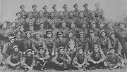Nenagh Battalion winners of the Command Trophy at  the FCA Competitions at Youghal 1950, front row, left to right, Pte Wm Kelly, Pte James Clifford, Pte Anthony Healy, Pte Michael Fahy, Pte Patrick Fitzpatrick, Pte Peter Cleary, Pte Patrick Hassett, second row left to right, Pte Garrett Grace, Sgt Dan Regan (training instructor), Pte Thomas Flannery, 2 Lt Richard P Walsh, Captain P J Keane (training officer), Comdt J C Donovan (area officer), 2 Lt John Hogan (platoon commander), 2 Lt Seamus Ryan (Adjutant), C Q M S Edwards Watson (battalion administrative officer), Pte Michael Moylan, Pte Michael Gavin, third row, left to right, Cpl Edward McGrath, Cpl Michael Flannery, Pte Michael Christie, Cpl Michael Hegarty, Pte Wm O'Donoghue, Pte Joseph Ryan, Pte Joe O'Meara, Pte John Linnane, Pte James Gleeson, Pte Sean Slattery, Pte Ed Eames, Pte Michael McGrath, Sergt Michael Finn (Pln Sergeant), fourth row, left to right, Pte James McGrath, Pte Martin Teefey, Pte Patrick Gilmartin, Pte John Ryan, Pte Sean Keane, Pte James Hogan, Pte Peter Doyle, Pte John Toohey, Pte Martin Kelly, back row, left to right, Pte Joseph Ryan, Pte Paddy Kennedy, Cpl Tony Whelan, Pte Edward Lalor, Pte Paddy Fitzgerald, Pte John Dunne, Pte Martin Collins, Pte Michael Ryan,
