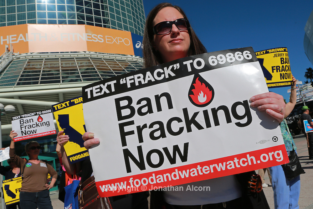 A woman holds a sign urging a ban on fracking outside the California Democratic convention in Los Angeles this month.