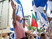 Emergency Rally for Israel outside the Israeli Embassy in Kensington, London, Great Britain <br /> 20th July 2014 <br /> <br /> Thousands of Israel supporters attended a rally outside the embassy in central London today, it was organised by Zionist Federation (ZF) to show solidarity with Israel and it's right to self-defence against terrorism. Speakers &amp; Guests at the rally included:<br /> Labour MP Louise Ellman <br /> Israeli ambassador H. E. Daniel Taub attended but did not speak. <br /> Board of Deputies president Vivian Wineman.<br /> ZF President Paul Churney<br /> <br /> Photograph by Elliott Franks