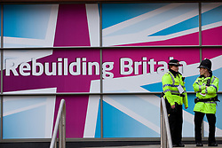 """© Licensed to London News Pictures. 01/10/2012. Manchester, UK . Police outside the conference by a """" Rebuilding Britain """" banner.  Labour Party Conference Day 2 at Manchester Central . Photo credit : Joel Goodman/LNP"""