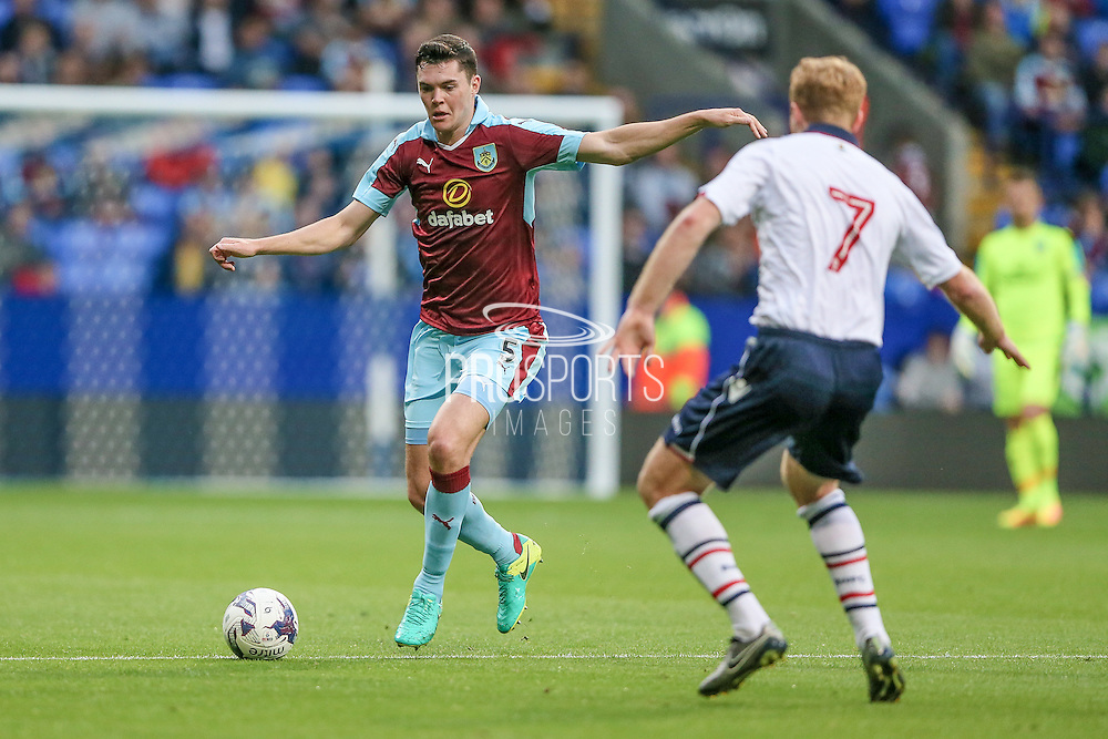 Michael Keane (Burnley) goes to run past Chris Taylor (Bolton Wanderers) during the Pre-Season Friendly match between Bolton Wanderers and Burnley at the Macron Stadium, Bolton, England on 26 July 2016. Photo by Mark P Doherty.