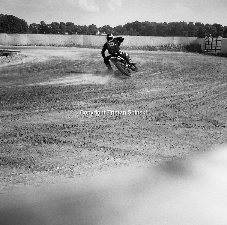 A racer skids around a turn during a motocross event in rural Sussex County Delaware.
