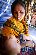 woman beggar with her baby, delhi, india