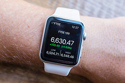 Summary of FTSE stock market performance  showing on an Apple Watch