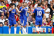 Diego Costa of Chelsea celebrates scoring his team's first goal to make it 1-1 with Andre Schurrle of Chelsea (14), Nemanja Matić of Chelsea (21) and Eden Hazard of Chelsea (right) during the Barclays Premier League match at Stamford Bridge, London<br /> Picture by David Horn/Focus Images Ltd +44 7545 970036<br /> 13/09/2014