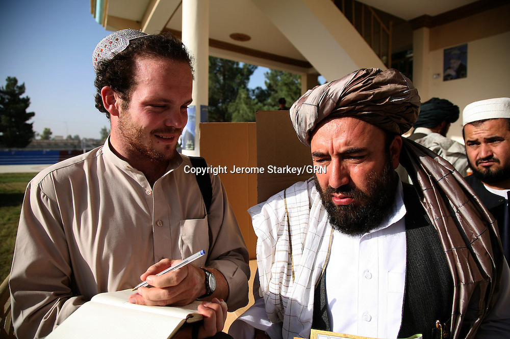 Sun Man Jerome Starkey interviews Afghan powerbroker Sher Mohammed Akhundzada at a polling station in Helmand's capital Lashkar Gah on the day of the Afghan presidential elections.